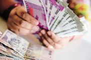 Rupee Edges Lower To 61.65 Per Dollar After Flat Opening