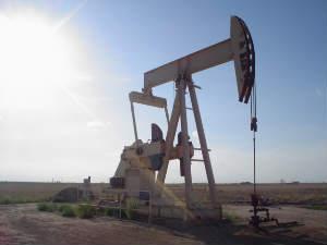 Oil prices retreat on poor economic data