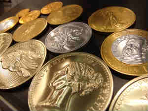 Gold slips on MCX, silver up