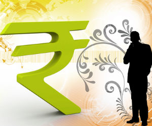 Rupee drops further against dollar, down 20 paise