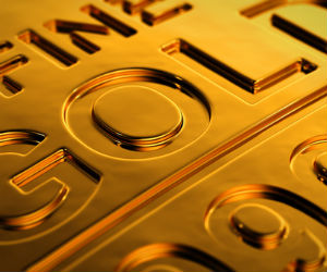 Gold drops marginally; set for yearly gains