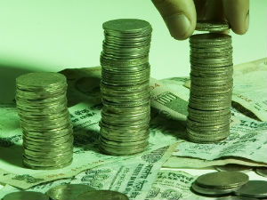 Rupee gains in early trade; rises above 60