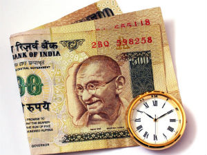 Rupee trades at 59.80 against dollar; drops 14 paise