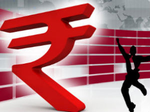 Rupee gains 20 paise in early trade at 61.35 to the dollar