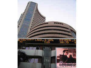 Markets trade higher; Sensex nears 21,000 points