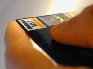 What are the different charges and fees associated with credit card transactions