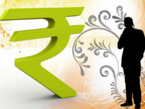Rupee trades higher again; up 11 paise at 61.84