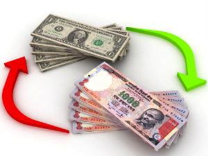 Rupee trades flat at 58.55 to the dollar