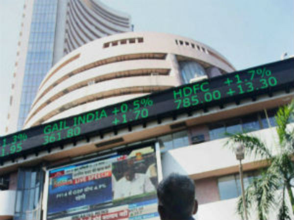 Sensex scales a new peak; trades a shade below 27,000 points