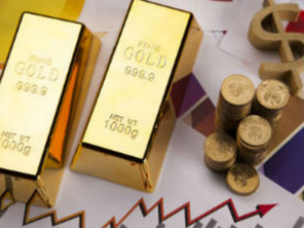 Gold lower as strong dollar weighs