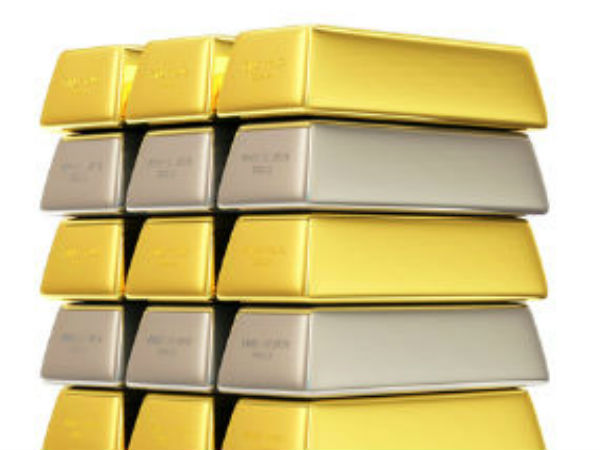 Gold Edges Up on Jewellers' Buying; Silver Falls
