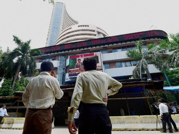 Markets Trade Lower On Weak Global Cues