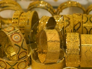 Gold Slides On Global Cues Muted Demand