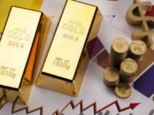 Gold Price Improves Slightly Amidst Strong Dollar